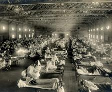 Soldiers from Fort Riley, Kansas, sick with Spanish flu at a hospital ward at Camp Funston: Wikipedia