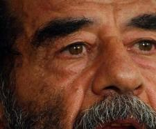 Saddam Speaks in Court | Public Domain https://en.wikipedia.org/wiki/Saddam_Hussein#/media/File:Saddam_Hussein_at_trial,_July_2004.JPEG | P