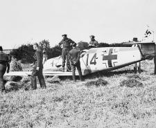 Army officers inspect the wreckage of Messerschmitt