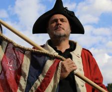 Al Murray dressed as an 18th century English soldier