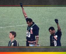 A photograph showing Tommie Smith and John Carlos raising their fist on the podium