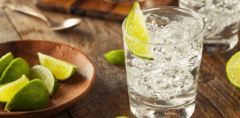 The Corn Laws introduced by William III's Corn Laws encouraged a boom in grain distillation resulting in gin becoming the de rigueur drink of the day