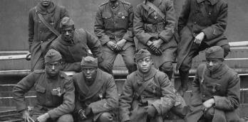 Soldiers of the 369th (15th N.Y.), awarded the Croix de Guerre for gallantry in action, 1919. Left to right. Front row: Pvt. Ed Williams, Herbert Taylor, Pvt. Leon Fraitor, Pvt. Ralph Hawkins. Back Row: Sgt. H. D. Prinas, Sgt. Dan Storms, Pvt. Joe William