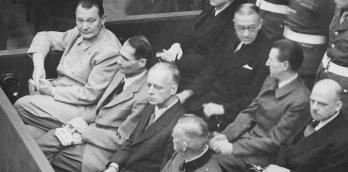 Nuremberg Trials. Defendants in their dock, circa 1945-1946, Herman Göring left | Wikipedia | Public Domain