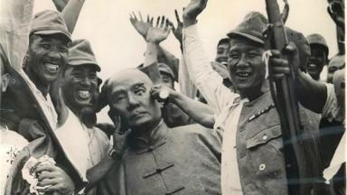 Japanese soldiers pose next to a bronze statue of Sun Yat-sen after capturing Shanghai: Wikipedia.