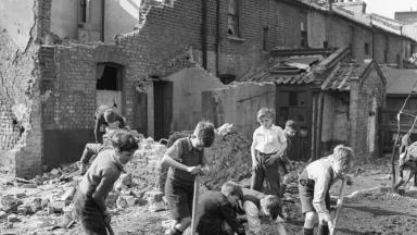 Boys creating an allotment on a bomb site in London during 1942