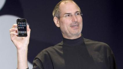 Apple CEO Steve Jobs holds up the first iPhone that was introduced at Macworld on January 9, 2007 in San Francisco, California (Getty).