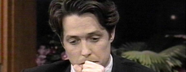 Hugh Grant thinking before speaking on the Tonight Show with Jay Leno