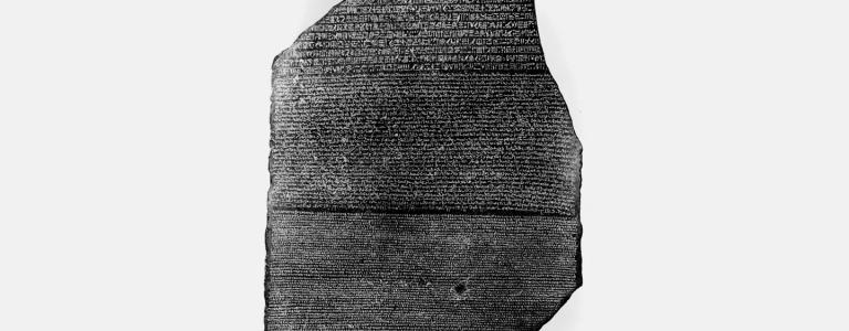 "The Rosetta Stone, on display at the British Museum, helped historians crack the riddle of hieroglyphics, a written language that had been ""dead"" for nearly 2,000 years."