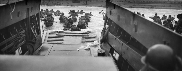 Into the jaws of death' | US troops disembark from a LCVP craft onto Omaha beach 6 June 1944
