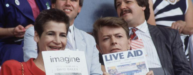 Singer David Bowie (David Jones) with a friend at the 'Live Aid' concert in Wembley Stadium, London.