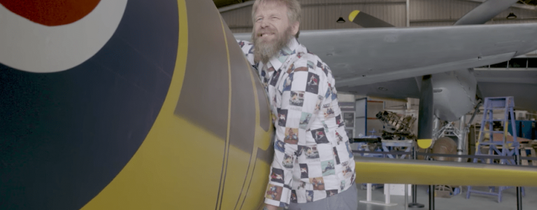 Meet comedian Tony Law, pictured above hugging his favourite WW2 aircraft.