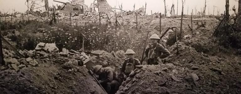 Left: a group of soldiers in the trenches, right: the ruined village of Athies, Pas-de-Calais, destroyed in the German retreat